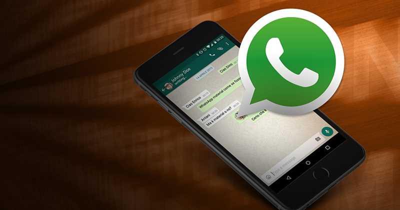 Celular con el logo de Whatsapp y mostrando el error del punto negro en iOS